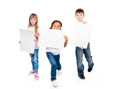 three funny children holding paper blanks in hands - stock photo