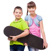 pretty children holding skateboard in hands - stock photo