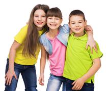 three happy children embrasing each other - stock photo