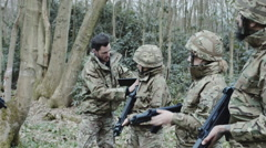 Army soldier giving instructions to team on training Stock Footage