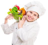 little girl-cook with bowl of vegetables on shoulder - stock photo