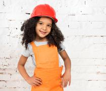 Little girl in orange repairmen uniform Stock Photos