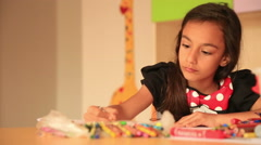 Cute little prescool girl drawing with colorful pencils 8 - stock footage