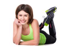 sport woman lying on the floor with her feet up - stock photo