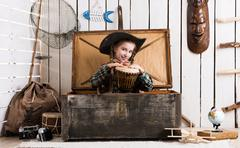 beautiful little girl in cowboy hat with drum - stock photo
