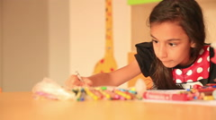Cute little prescool girl drawing with colorful pencils 9 - stock footage