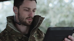 Army Instructor with Digital tablet and headphone giving instructions Stock Footage
