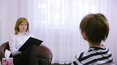 Female psychologist making notes during psychological therapy session. sad girl Stock Footage