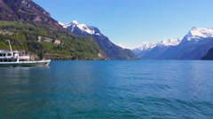 Boat on lake Lucerne (Vierwaldstatersee) with Swiss Alps, Switzerland Stock Footage