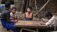 Poor children playing a board game in the street , Mrauk U . Myanmar, Burma Stock Footage