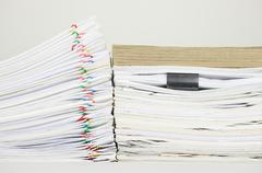 Overload paperwork have brown envelope on document with white background - stock photo