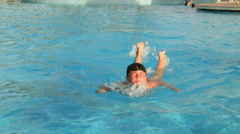 Little swimmer swimming Stock Footage