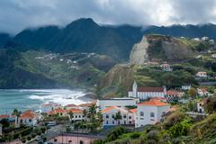 Porto da Cruz town surrounded by volcanic rocks and mountains, Madeira island - stock photo