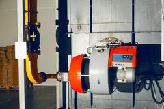 Gas burner on the industrial steam boiler Stock Photos