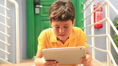 Young boy using digital tablet 4 Stock Footage