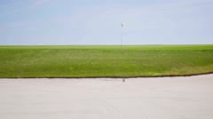 View from the sand bunker on a golf course Stock Footage