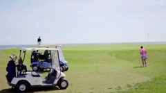 Two golf carts with golf bags on a golf course Stock Footage