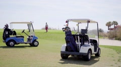 Two golf carts loaded with bags and equipment Stock Footage