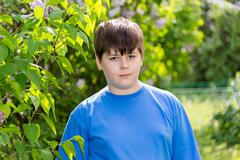 Boy of about 12 years in Park Stock Photos