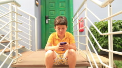 Young boy using smartphone Stock Footage
