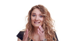 Pretty curly blondie woman shocked and surprised. Close up. Slow motion Stock Footage