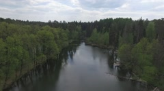 Aerial Shot Of Woods And Lake Stock Footage