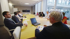 4K Diverse business team engaged in a conference call in boardroom meeting - stock footage