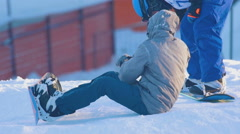 Snowboarders preparing to perform acrobatic jumps in training Stock Footage
