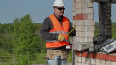 Builder using measuring tape Stock Footage