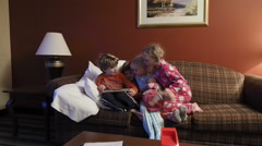 Children Sitting On Couch Playing With Tablet Computer - stock footage