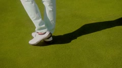 Close up on walking woman at golf course Stock Footage