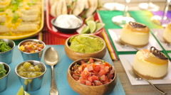 Fiesta party buffet table with dulce de lecheand other traditional Mexican food. Stock Footage