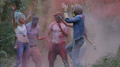 4K Happy hipster friends at music festival, dancing & throwing coloured powder.  Stock Footage