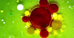 Color drops floating over colourful background with oil painting effect - stock footage