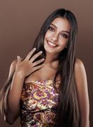 Cute happy young indian woman in studio close up smiling, fashion mulatto beauty Stock Photos