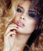 Portrait of beauty blond young woman through black lace close up sensual Stock Photos
