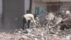 Man Searching For Precious Cooper Wire In Earthquake Destroyed Building Stock Footage