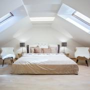 Bright attic bedroom in the fashionable apartment - stock photo