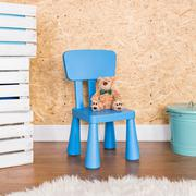 Little blue chair for little man Stock Photos