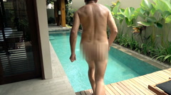 Naked man jumping into swimming in pool, super slow motion 240fps  Stock Footage