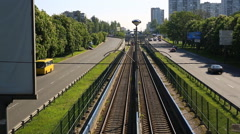 Train passing through countryside, moving railroad tracks Stock Footage