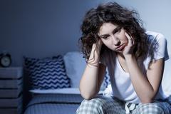 Everyday worries deprive her of good night's sleep - stock photo