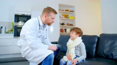 home the doctor came to little boy and ask about his health. boy feels well and - stock footage