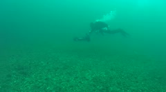 The diver is moving on an underwater scooter. Stock Footage