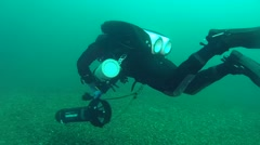 The diver starts moving on an underwater scooter. Stock Footage