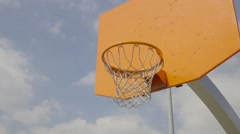Teenager plays basketball, throws ball into basket, slow motion. Stock Footage