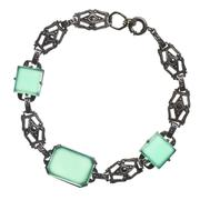 Antique bracelet with green stones Stock Photos