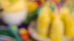 Fiesta party buffet table with spicy mexican corn on the cob and other tradition Stock Footage