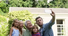 Multi-generational family taking a funny picture Stock Footage