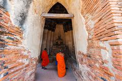 Monks sacred ancient Buddha statue, Ayutthaya - stock photo